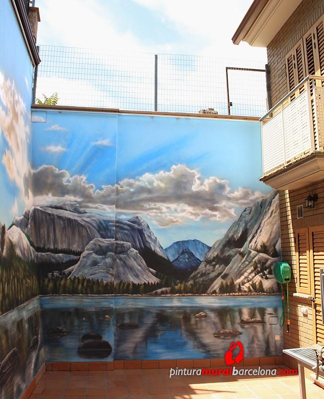 mural-patio-interior-paisaje-lago-arboles-graffiti-montanas