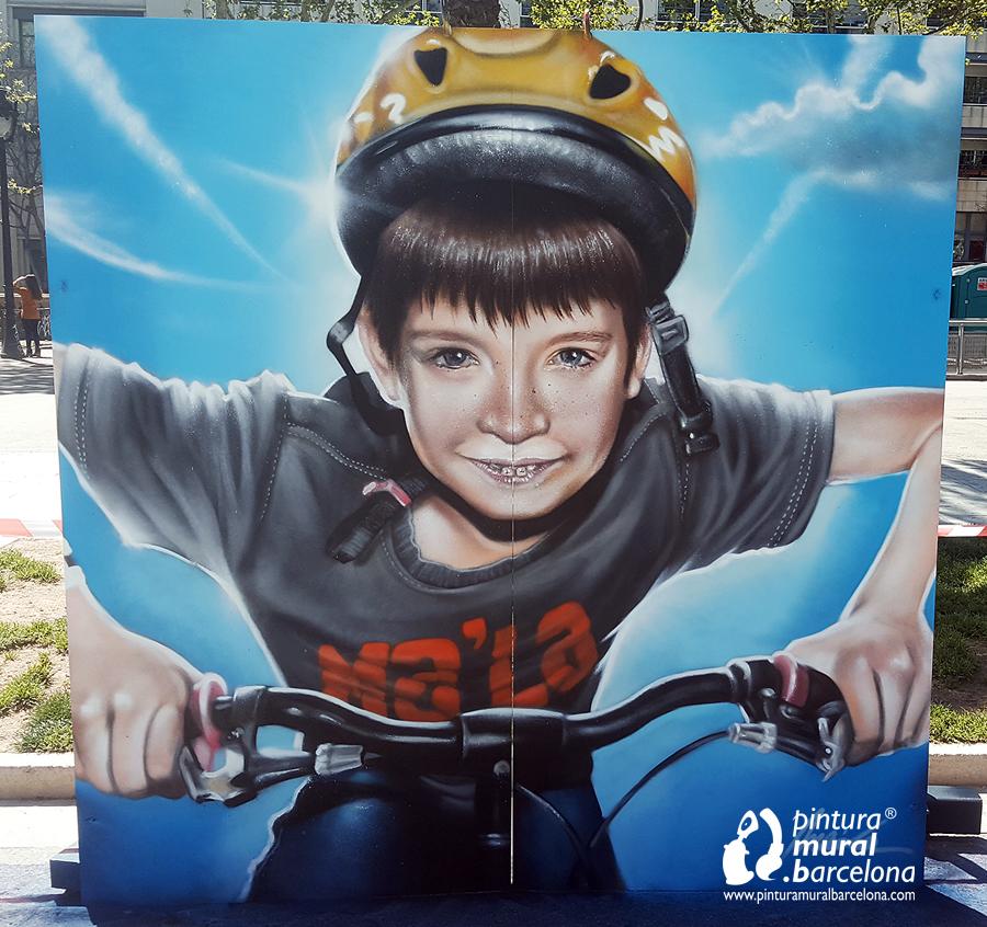 graffiti-mural-bici-niño-retrato-caricatura